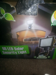 LED 60 solar flood light brand new in box $35 firm lowered