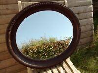 Oval mirror in oak frame