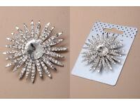Silver coloured crystal starburst brooch. - JTY215