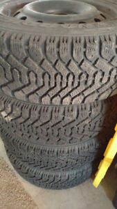4 Goodyear nordic tires, on 4x100 steel rims 195/60-15