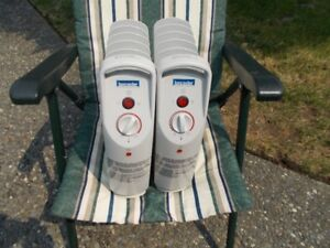 Two lancaster Oil filled Mini-Heaters