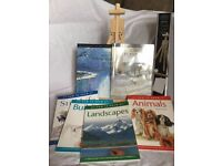 Various art/drawing books also folding table easel.
