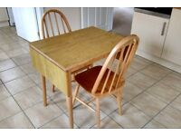 Extending dining/kitchen table and two matching chairs