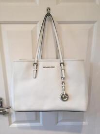 Designer Michael Kors genuine jet set travel tote shoulder bag in white