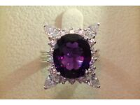 6 Carat amethyst cluster with 1.33 carat diamond halo ring set in 18 K white gold