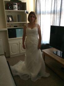 Beautiful fitted size 10-12 wedding dress