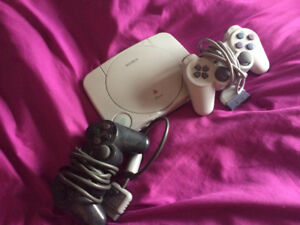 Playstation 1 (2 controllers + 25 Games)