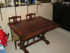 Oak draw leaf table, 2 barley twist captains chairs, 4 carved ch
