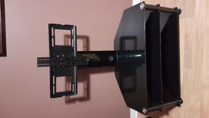 Glass tv stand with attatched tv mount