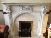 Gas fire with marble hearth and backing and a wooden surround
