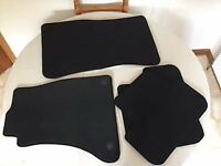 4 black Audi A4 carpet mats.