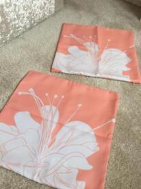 Peach and white cushion covers
