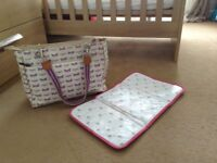 Baby changing bag with changing mat