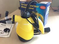 Portable hand held steam cleaner