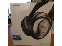 Brand New Bose Noise Cancelling Headphones. Damaged package. Unopened instill in Cellophane