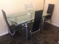 Dinnig table and 6 chairs