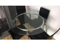 Glass/chrome-plated Round Table With 4 Black chair with cushions