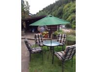 Garden table and chairs plus umbrella