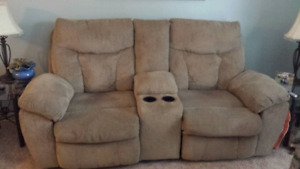 Ashley. Electric couch with console and drink holders.