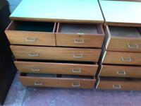 Pair of solid teak Formica topped chests of drawers.