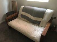 Dark wood futon, free to collect