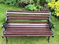 Cast iron lion crested garden bench with wooden plus low table