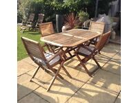 Garden patio wooden table and 4 folding chairs £80 tel 07966921804