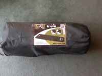 Self-inflating camping mat with cover