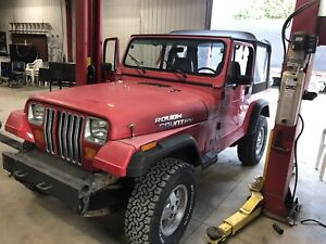 "1991 Jeep YJ 2.5"" lift with lots of extra parts"