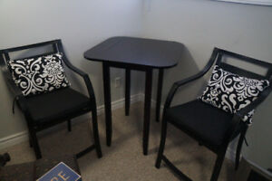 Two counter height chairs and Table