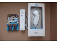 Wii-mote + NEW Boxed Nunchuck + NEW Duracell Ultra Battery pack