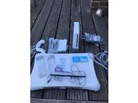 Nintendo Wii Bundle - console, controllers, cables, games, instructions