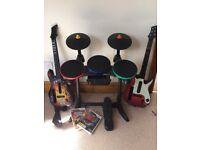 Guitar hero guitars and drum kit and games