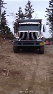 Dump truck with plow and wing