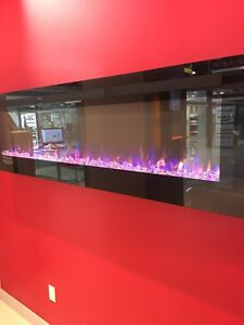 "ELECTRIC FIREPLACE. 40""50""60""70""VISIT OUR SHOWROOM"