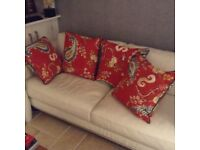 4 cushions from t k maxx as new cost £68 selling for £25 tel 07966921804
