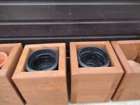 SOLID WOOD GARDEN PLANTERS £25.00 THE PAIR .