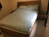 King size bed, memory foam mattress, matching bed-side tables.