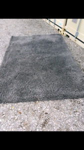 Grey shabby accent rug, clean
