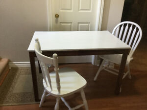 solid wood dining table and 3 chairs deliveyr included