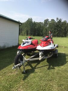 2 seadoos and trailer plus covers low hours