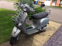 Vespa automatic scooter lx 125 touring