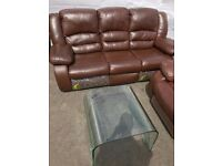 Clear curved glass coffee table