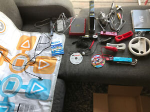 2 Wii's + games (NHL, Just Dance x2) 3 controllers, all cables