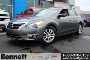 2014 Nissan Altima Auto with A/C and lots of room.