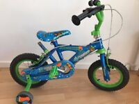 Childs bike with stablisers