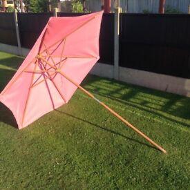 Pink parasol for garden patio table £10 tel 07966921804