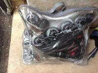 Rollerblades, brand new and unused, adult size 7.