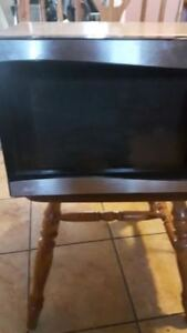 Medium size stainless steel /Black in color Microwave - Ex Cond