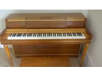Wurlitzer upright piano with matching stool. Plays well, needs tuning. Collection only.